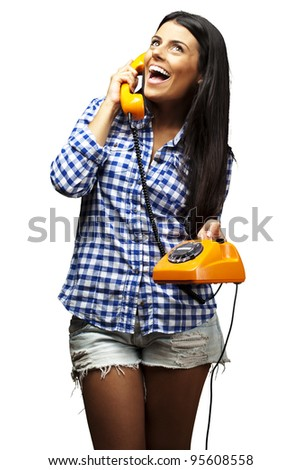portrait of young woman talking on vintage telephone over white - stock photo
