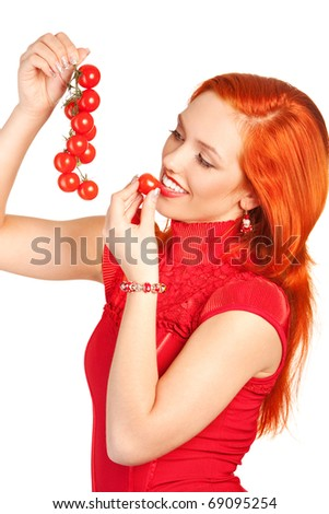 portrait of young woman tasting a cherry tomatoes