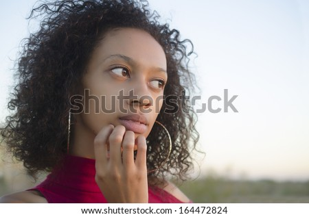 Portrait of young woman thinking - stock photo