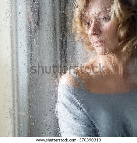 Portrait of Young woman throw the rain drops