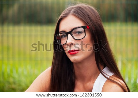 Portrait Of Young Woman Wearing Hipster Glasses On Sports Playground