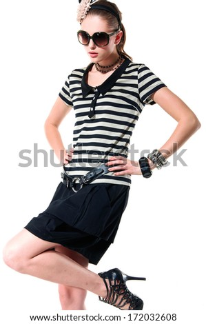 portrait of young woman wearing sunglasses in stripy t-shirt