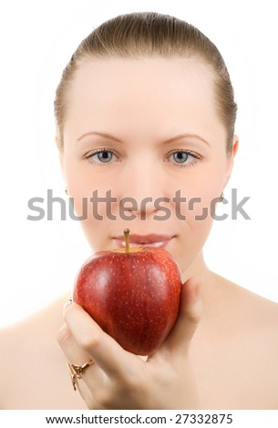 Portrait of young woman with apple isolated on white
