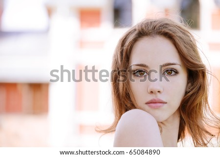 Portrait of young woman with bared shoulders. - stock photo