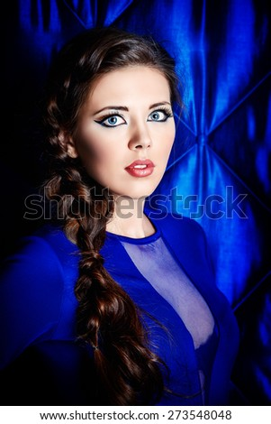 Portrait of young woman with beautiful big eyes. Make-up, cosmetics.  - stock photo