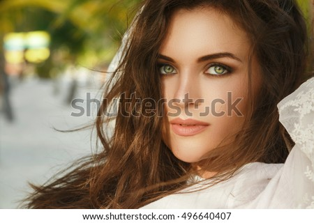Portrait of young woman with beautiful eyes on the beach