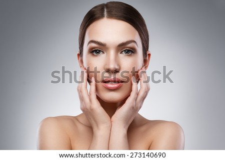 Portrait of young woman with beautiful face - stock photo