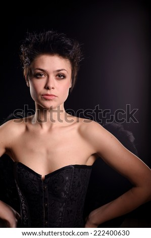 portrait of young woman with black short hairs - stock photo