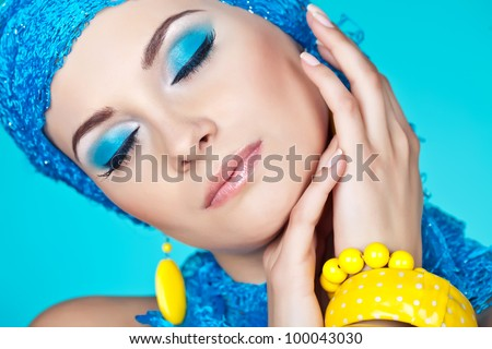 Portrait of young woman with blue make-up - stock photo