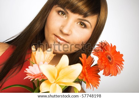 Portrait of young woman with  bouquet