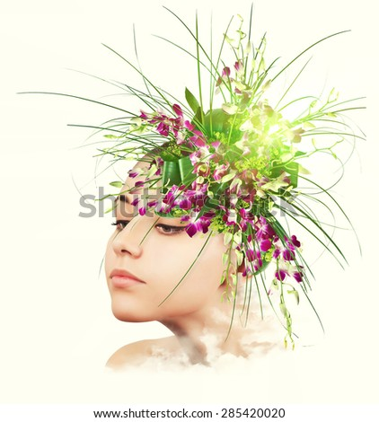 Portrait of young woman with bouquet of flowers. - stock photo
