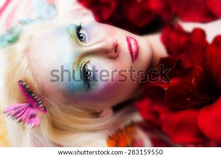 Portrait of young woman with creative make up. - stock photo