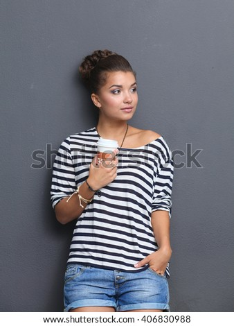 Portrait of  young woman with cup  tea or coffee - stock photo