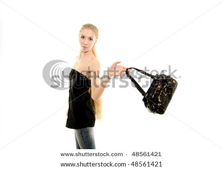 Portrait of young woman with dark handbag