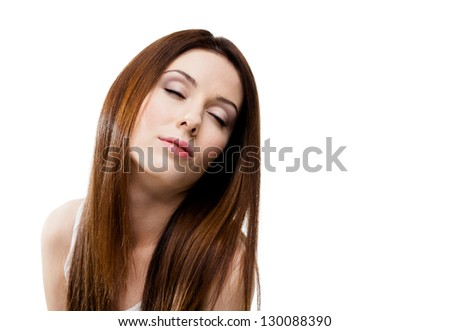 Portrait of young woman with eyes closed with creamy complexion, isolated on white - stock photo