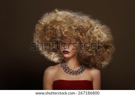 Portrait of Young Woman with Futuristic Hairdo - stock photo