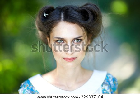 Portrait of young woman with hairstyle. Face with freckles closeup - stock photo