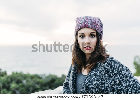Portrait of young woman with hat at outdoors