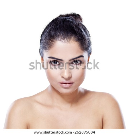 Portrait of young woman with healthy skin and perfect face looking at the camera, isolated on white background - stock photo