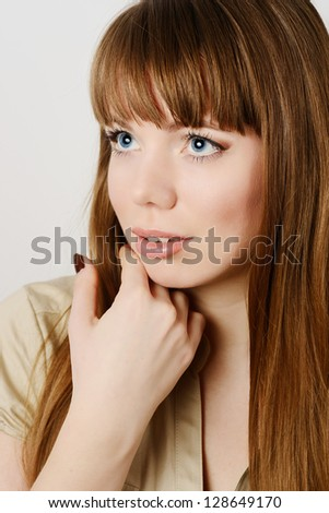 portrait of young woman with long hair - stock photo
