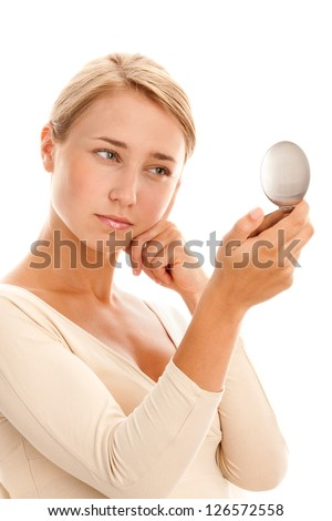 Portrait of young woman with mirror - stock photo