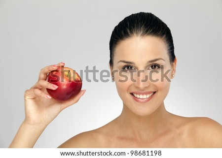 Portrait of young woman with red apple
