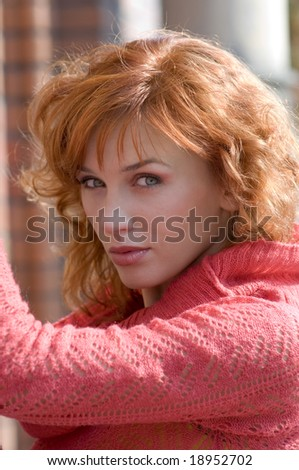 portrait of young woman with red hair in autumn sun