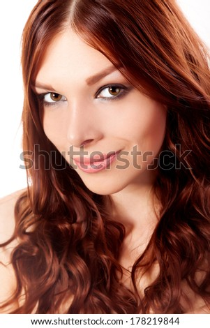 Portrait of young woman with red hair isolated on a white background