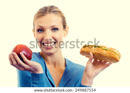 Portrait of young woman with sandwich and red apple, beauty and healthy eating concept. - stock photo