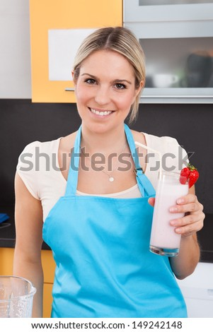 Portrait Of Young Woman With Strawberry Milkshake