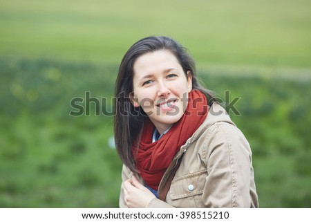 Portrait of young woman with the meadow as background - stock photo