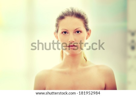 Portrait of young woman without a make-up - stock photo