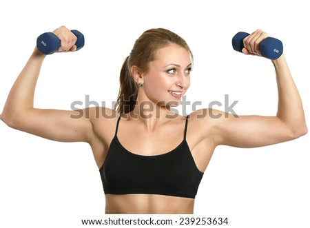 Portrait of young woman workout with dumbbells on white