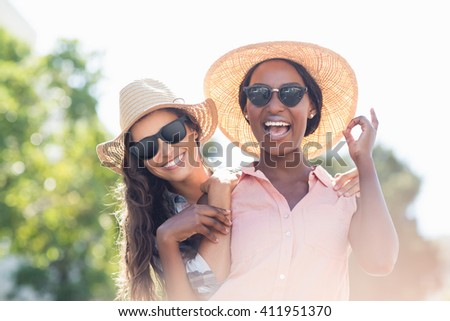 Portrait of young women in sunglasses smiling