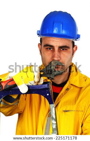 Portrait of young worker with a wrench
