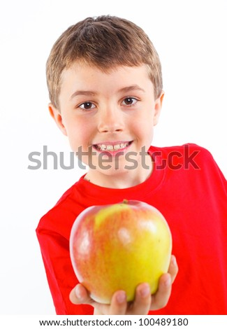 Portrait og cute boy with apple. Isolated on white background. - stock photo