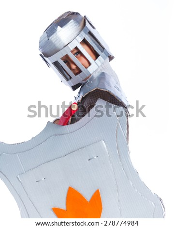 Portrait og young boy dressed as a Knight isolated on white - stock photo