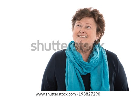 Portrait: older woman isolated over white smiling up to text. - stock photo