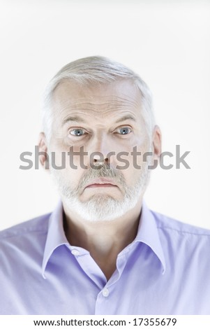 portrait on isolated withe background of a handsome expressive senior