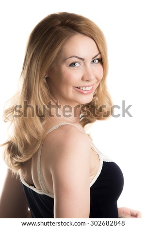 Portrait on white background of young attractive blond playfully smiling Caucasian woman wearing casual clothes, studio shot - stock photo