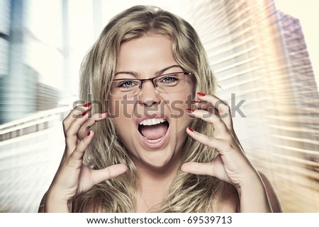 Portrait on  wildly  screaming woman on color back - stock photo