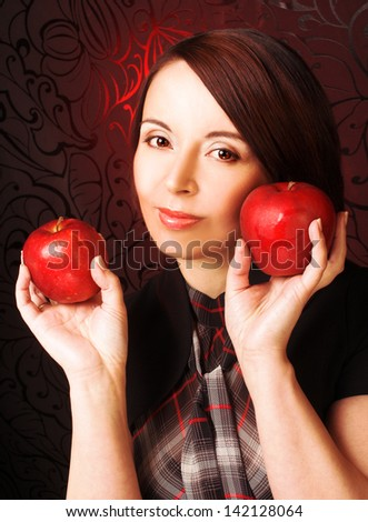 Portrait on woman with red apples