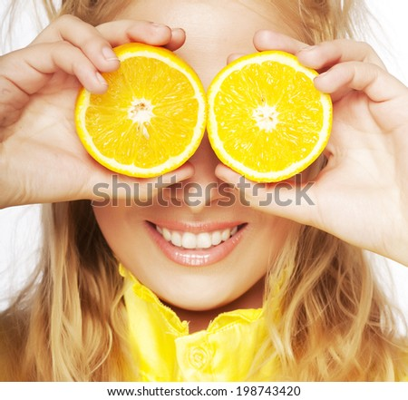 Portrait on young and healthy woman with orange isolated on white - stock photo