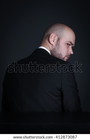 Portrait pensive stylish and brutal bald man with a beard