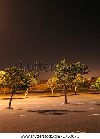 Portrait photo of a parking lot at night. - stock photo