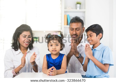 portrait photo of happy indian family - stock photo