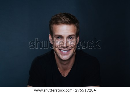 Portrait photo of young happy man with a blinding smile in v neck t shirt - stock photo