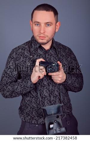 Portrait photographer with vintage camera - stock photo