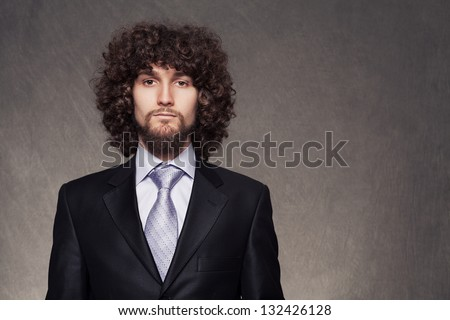 portrait picture of a young elegant businessman with copyspace on grunge background - stock photo