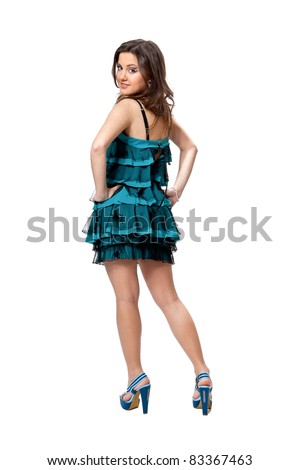 Portrait pretty girl in a turquoise dress smiling poses in studio isolated on white - stock photo